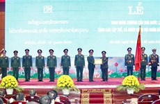 越南和老挝两国国家勋章授勋仪式在河内隆重举行