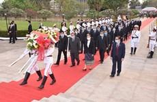 老挝各地纷纷举行老挝人民革命党建党65周年纪念活动
