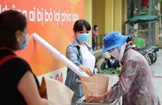 """河内市首台""""取米机""""问世助力困难群众渡过疫情难关"""