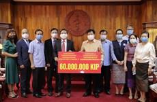 老挝卫生部部长: 不管遇到任何困难越南都与老挝人民共同分担困难