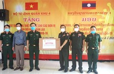 国防部第四军区司令部向老挝人民军队捐赠防疫医疗物资