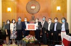 旅居泰国和韩国越南人援助越南新冠肺炎疫情防控战役