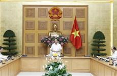 政府总理与企业对话会:越南企业和越南经济朝着积极方向发展