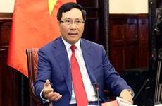 越南政府副总理兼外长范平明会见日本驻越大使