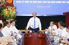 越南政府总理阮春福走访人民报社 祝贺革命新闻日95周年