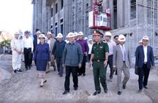 老挝总理对由越南援建的国会大厦工程的进度和质量予以高度评价