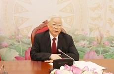 越共中央总书记、国家主席阮富仲与老挝人民革命党中央总书记、国家主席本扬·沃拉吉举行电话会谈