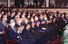 老挝人民民主共和国国庆45周年暨凯山·丰威汉主席诞生100周年纪念典礼在河内举行