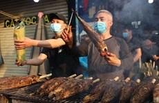 越南财神节独特供奉品--烤鳢鱼
