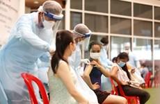 柬埔寨向第2百万名新冠疫苗接种者授予奖金 新加坡收紧社交距离措施