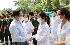 越南政府总理范明政:许多人希望优先为疫情重灾区进行新冠疫苗接种