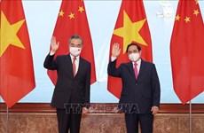 越南政府总理范明政会见中国国务委员、外交部长王毅