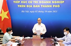 国家主席阮春福与胡志明市企业选民接触