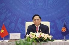 范明政会见出席第十六届东亚峰会的各国驻越南大使和临时代办