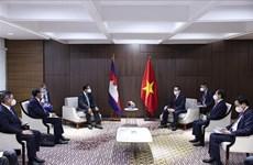 越南政府总理范明政分别会见埔寨首相、新加坡总理和马来西亚总理