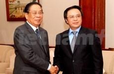 越共中央对外部高级代表团访问老挝