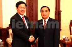 老挝政府总理会见越南财政部高级代表团