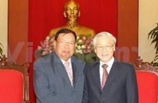 越南党和国家领导人分别会见老挝国家副主席本扬•沃拉吉