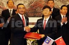 中国与马来西亚签署打击跨国犯罪的合作协议
