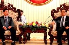 老挝总理通辛会见越南教育部老干部代表团