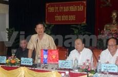 越南政府副总理同老挝政府副总理举行会谈