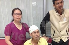 2014年东南亚男足锦标赛:受伤的越南球迷得到及时救助