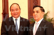 越南政府副总理阮春福对老挝进行工作访问
