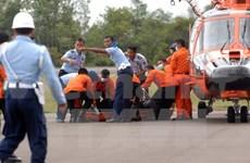 亚航失事客机首批遇难者遗体运抵泗水
