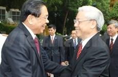 老挝高级代表团抵达河内 开始对我国进行正式访问