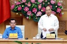 阮春福出席政府与劳动总联合会协调工作会议