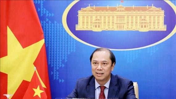 越南外交部副部长阮国勇与加拿大总理助理大卫·莫里森通电话