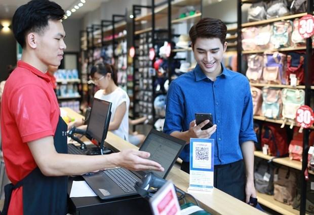 QR Pay 正改变越南人现金消费的习惯 hinh anh 1