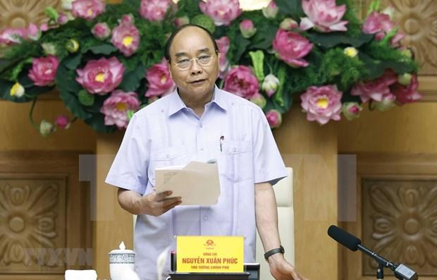 阮春福总理主持召开有关信贷体系结构重组的会议 hinh anh 1