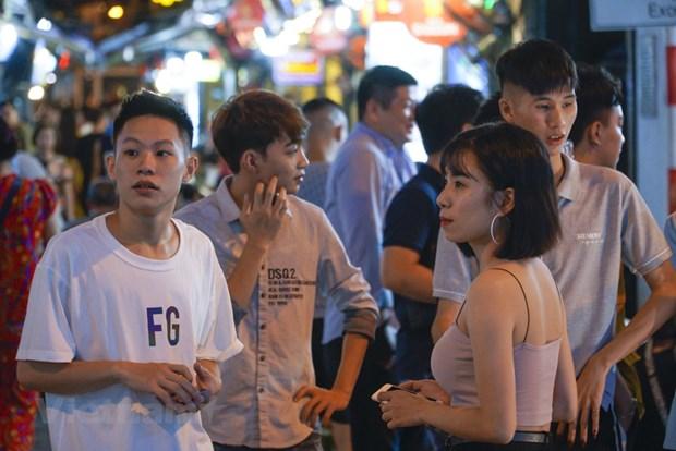 组图:取消社交距离规定后首都河内'通宵街'又热闹起来 hinh anh 9