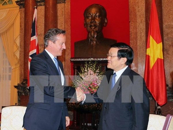越南国家主席张晋创会见英国首相卡梅伦 hinh anh 1