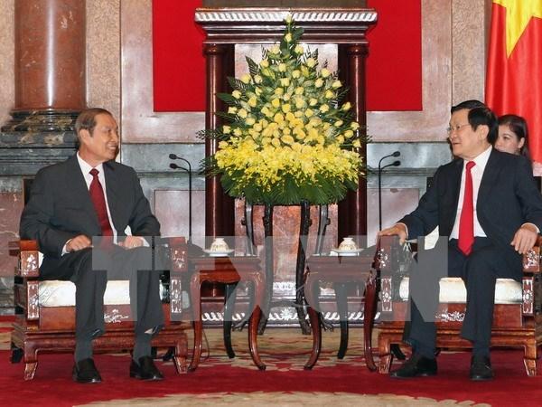 越南国家主席张晋创会见老挝国家主席办公室主任 hinh anh 1