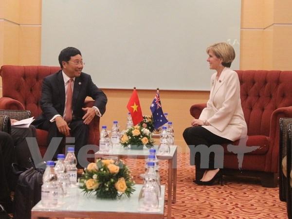 越南政府副总理兼外长同欧盟外交与安全政策高级代表和澳大利亚外长会晤 hinh anh 1