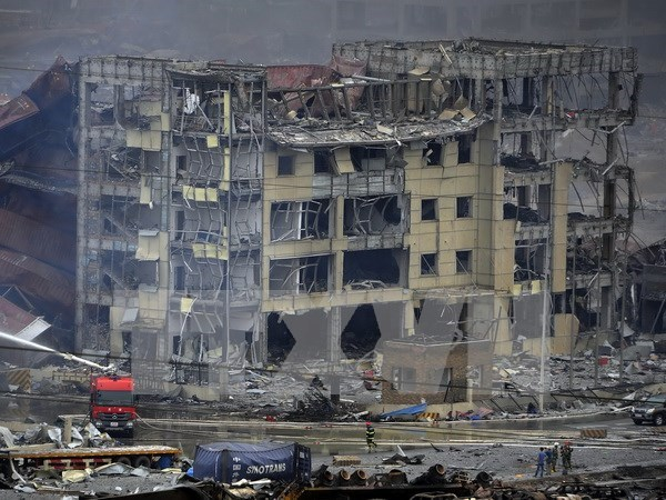 越南政府副总理兼外交部长范平明就天津港爆炸事故向中方致慰问电 hinh anh 1