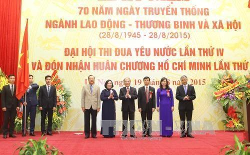 阮生雄主席出席越南劳动荣军与社会部门传统日70周年纪念典礼 hinh anh 2