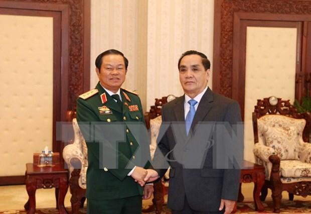 老挝领导人高度评价越老两军的有效合作 hinh anh 1