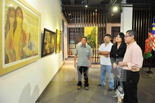 庆祝马来西亚国庆58周年纪念典礼在胡志明市举行 hinh anh 1