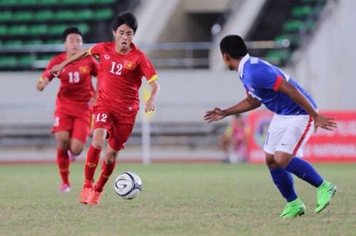 2015年东南亚U19足球锦标赛:越南队与马来西亚队握手言和 hinh anh 1