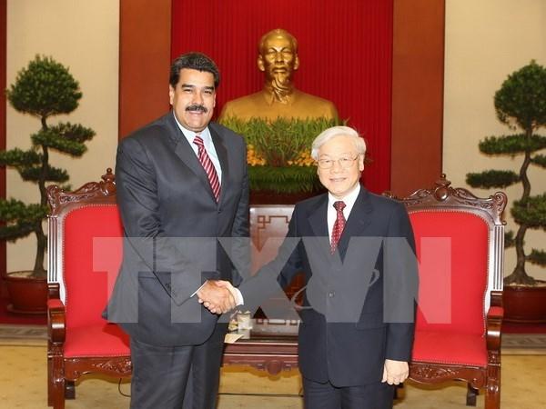 越共中央总书记阮富仲会见委内瑞拉总统、统社党主席马杜罗 hinh anh 1