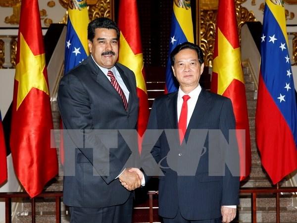 越南政府总理阮晋勇会见委内瑞拉总统尼古拉斯•马杜罗 hinh anh 1