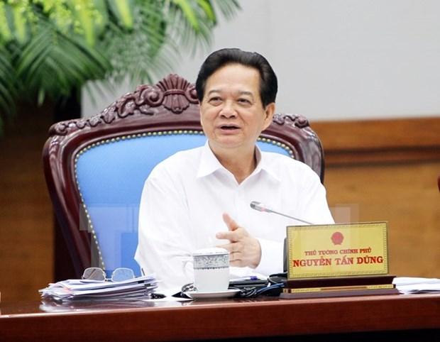 越南政府总理:确保汇率稳定和宏观经济稳健运行 hinh anh 1