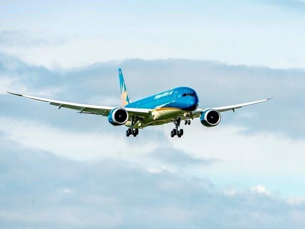越航波音787-9梦幻客机抵达英国希思罗机场 hinh anh 1