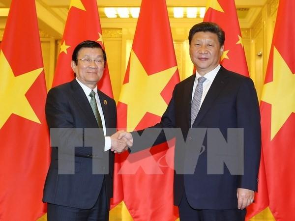 越南国家主席张晋创会见中共中央总书记、国家主席习近平 hinh anh 1