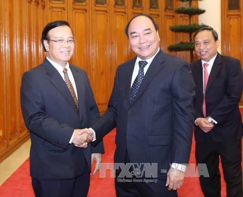 越南政府副总理阮春福会见老挝计划和投资部代表团 hinh anh 1