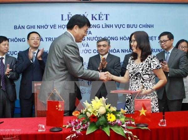 越南信息传媒部同中国国家邮政局加强合作 hinh anh 1