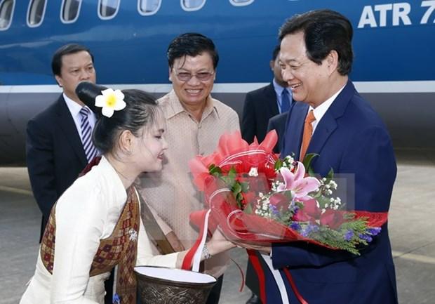 越南政府总理阮晋勇会见老挝越南投资商 hinh anh 1